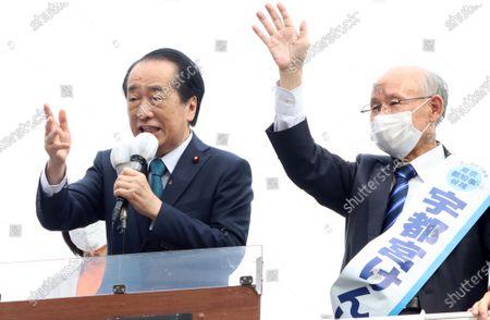 Former Japanese Prime Minister Naoto Kan (L) delivers a speech for Kenji Utsunomiya (R), former president of Japan Federation of Bar Associations for the Tokyo gubernatorial election campaign in Tokyo on Saturday, June 20, 2020. Official campaign for the July 5 Tokyo gubernatorial election with 22 candidates including Tokyo Governor Yuriko Koike started on June 18.