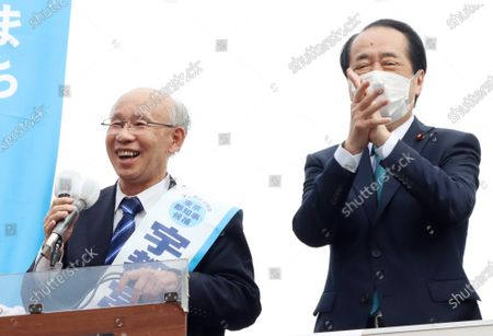 Former president of Japan Federation of Bar Associations Kenji Utsunomiya (L) delivers a campaign speech for the Tokyo gubernatorial election in Tokyo on Saturday, June 20, 2020, while former Prime minister Naoto Kan (R) claps his hands. Official campaign for the July 5 Tokyo gubernatorial election with 22 candidates including Tokyo Governor Yuriko Koike started on June 18.