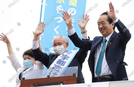 Former president of Japan Federation of Bar Associations Kenji Utsunomiya (C) accompanied by former Prime Minister Naoto Kan (R) and Social Democratic Party leader Mizuho Fukushima (L) reacts to audience as he delivers a campaign speech for the Tokyo gubernatorial election in Tokyo on Saturday, June 20, 2020. Official campaign for the July 5 Tokyo gubernatorial election with 22 candidates including Tokyo Governor Yuriko Koike started on June 18.