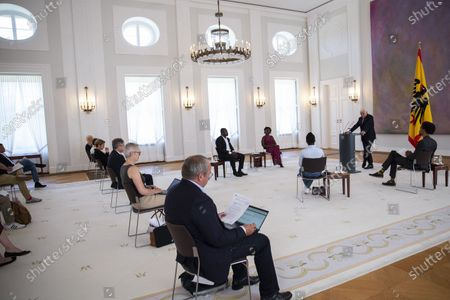 """German President Frank-Walter Steinmeier (C) speaks with Gerald Asamoah (first raw L-R), former football player, Gloria Boateng, teacher and education activist, Vanessa Tadala Chabvunga, from Jewish high school Moses Mendelssohn and Daniel Gyamerah division manager of Think-Tanks """"Citizens For Europe"""" in Berlin while hosting a discussion on racism in Germany at Schloss Bellevue palac. German cities have seen their own share of protests against racism and police violence since the death of George Floyd in the USA."""