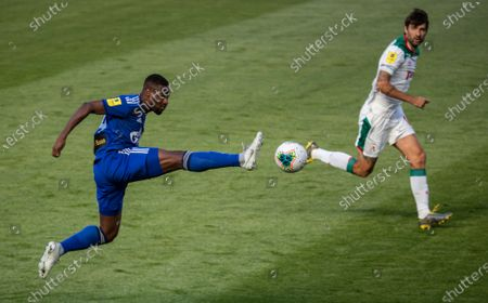 Stock Image of Mamadou Sylla of Orenburg in action against Vedran Corluka (R) of FC Lokomotiv Moscow during Russian Premier League match between FC Lokomotiv Moscow and Orenburg in Moscow, Russia, 21 June 2020. Russian Soccer Premier League restarts matches after a lockdown caused by coronavirus pandemic with limited quantity of fans.