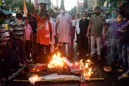 Protesters burning an effigy of Chinese president, Xi Jingping and Chinese flags during the demonstration. Indians protest against Chinese intrusion into Indian Territory in a border brawl with Indian army where 20 of Indian soldiers were martyred on 15th June night at Galwan Valley in ladakh. Reports suggest that the Chinese side also suffered a number of casualties.