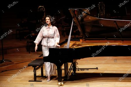 Stock Picture of French-Georgian pianist Khatia Buniatishvili reacts as she performs at the Philharmonie in Paris as part as the France's annual music festival, France, 21 June 2020. France's annual music festival (Fete de la musique) runs every 21 June to mark the summer's start.