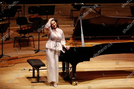 Stock Image of French-Georgian pianist Khatia Buniatishvili reacts as she performs at the Philharmonie in Paris as part as the France's annual music festival, France, 21 June 2020. France's annual music festival (Fete de la musique) runs every 21 June to mark the summer's start.