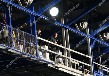 Sky pundits Gary Neville and Jamie Carragher watch the game during the English Premier League soccer match between Everton FC and Liverpool FC in Liverpool, Britain, 21 June 2020.
