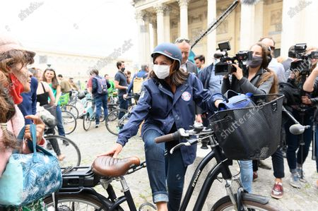 Stock Photo of Anne Hidalgo, Paris city hall candidate in the upcoming mayoral elections on 2020, Socialist Party (PS) and actual Paris mayor Anne Hidalgo wearing protective face mask , ride her bicycle with David Belliard of the Europe Ecologie Les Verts (EELV)  and Audrey Pulvar