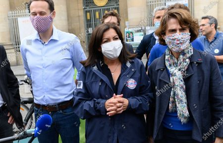 Anne Hidalgo, Paris city hall candidate in the upcoming mayoral elections on 2020, Socialist Party (PS) and actual Paris mayor Anne Hidalgo wearing protective face mask , ride her bicycle with David Belliard of the Europe Ecologie Les Verts (EELV)  and Audrey Pulvar