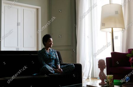 On, American content creator Tamu McPherson sits on the sofa at her home in Milan, Italy. The U.S protests against systemic racism, which are spreading around the globe, are now putting the spotlight on the fashion world in its role as a cultural beacon, and emboldening insiders -- some with lucrative deals that often assume their discretion -- to speak up