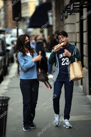 Emanuela Folliero and her son Andrea stroll through the streets of the center while eating an ice cream cone. Here they are together walking in via Montenapoleone.