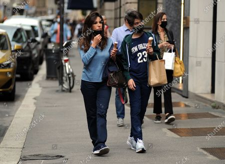 Stock Image of Emanuela Folliero and her son Andrea stroll through the streets of the center while eating an ice cream cone. Here they are together walking in via Montenapoleone.