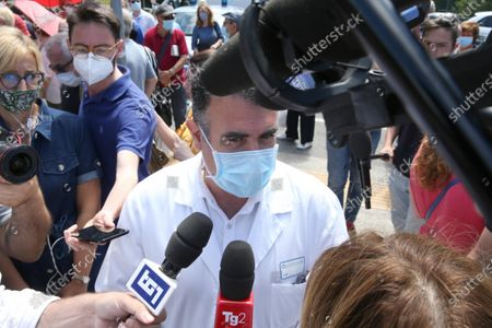 Italian director Roberto Gusinu addresses the media outside the Siena hospital where the Italian driver Alex Zanardi is hospitalized after the road accident, during one of the stages of the relay of Obiettivo tricolore, near Siena, Italy, 22 June 2020. Four-time paralympic champion and former Formula One driver Alex Zanardi was involved in a serious road accident on 19 June in the province of Siena while taking part in a race on his handbike during one of the stages of the relay of Obiettivo tricolore.
