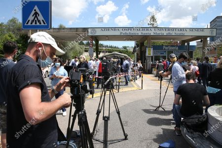 Members of the media gather at the Siena hospital 'Le Scotte'where the Italian driver Alex Zanardi is hospitalized after the road accident during one of the stages of the relay of Obiettivo tricolore, near Siena, Italy, 22 June 2020. Four-time paralympic champion and former Formula One driver Alex Zanardi was involved in a serious road accident on 19 June in the province of Siena while taking part in a race on his handbike during one of the stages of the relay of Obiettivo tricolore.