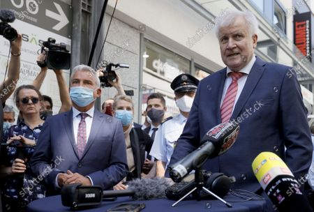 German Interior Minister Horst Seehofer (R) speaks next to Baden-Wuerttemberg's Interior Minister Thomas Strobl (L) during a visit to the downtown shopping area in Stuttgart, Germany, 22 June 2020. Several hundreds of rioting youths vandalized and looted dozens of shops in the center of Stuttgart, the capital of the federal state of Baden-Wuerttemberg, in the early morning of 21 June 2020, reports state. The rioters also hurled rocks at police officers until the situation calmed down around 3 am. Authorities have yet to provide an explanation about what exactly sparked the unrest.