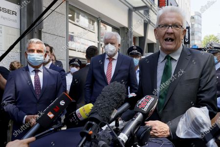 Baden-Wuerttemberg's State Premier Winfried Kretschmann (R) speaks during a statement next to German Interior Minister Horst Seehofer (C) and Baden-Wuerttemberg's Interior Minister Thomas Strobl (L) during a visit to the downtown shopping area in Stuttgart, Germany, 22 June 2020. Several hundreds of rioting youths vandalized and looted dozens of shops in the center of Stuttgart, the capital of the federal state of Baden-Wuerttemberg, in the early morning of 21 June 2020, reports state. The rioters also hurled rocks at police officers until the situation calmed down around 3 am. Authorities have yet to provide an explanation about what exactly sparked the unrest.