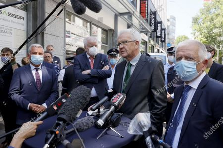 Baden-Wuerttemberg's State Premier Winfried Kretschmann (2-R) speaks during a statement next to German Interior Minister Horst Seehofer (2-L), Baden-Wuerttemberg's Interior Minister Thomas Strobl (L) and Mayor of Stuttgart, Fritz Kuhn (R) during a visit to the downtown shopping area in Stuttgart, Germany, 22 June 2020. Several hundreds of rioting youths vandalized and looted dozens of shops in the center of Stuttgart, the capital of the federal state of Baden-Wuerttemberg, in the early morning of 21 June 2020, reports state. The rioters also hurled rocks at police officers until the situation calmed down around 3 am. Authorities have yet to provide an explanation about what exactly sparked the unrest.