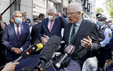 Baden-Wuerttemberg's State Premier Winfried Kretschmann (R) speaks next to German Interior Minister Horst Seehofer (C) and Baden-Wuerttemberg's Interior Minister Thomas Strobl (L) during a visit to the downtown shopping area in Stuttgart, Germany, 22 June 2020. Several hundreds of rioting youths vandalized and looted dozens of shops in the center of Stuttgart, the capital of the federal state of Baden-Wuerttemberg, in the early morning of 21 June 2020, reports state. The rioters also hurled rocks at police officers until the situation calmed down around 3 am. Authorities have yet to provide an explanation about what exactly sparked the unrest.