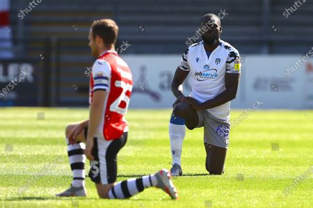 Frank Nouble of Colchester United takes a knee before kick off