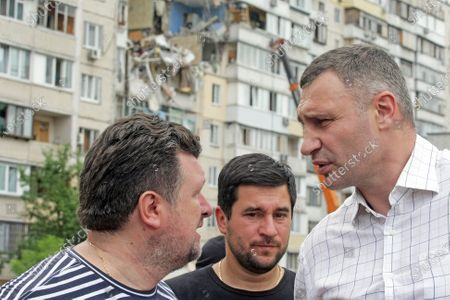 Kyiv city head Vitali Klitschko  (R) visits the scene of the explosion in a nine-storey building in the Darnytskyi district of Kyiv, capital of Ukraine. An explosion went off on Sunday morning, June 21, killing three people. Another three people are missing while 100 residents will have to leave their homes. The investigation is ongoing.