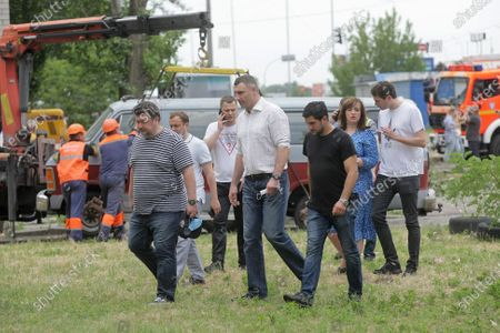 Kyiv city head Vitali Klitschko (C) visits the scene of the explosion in a nine-storey building in the Darnytskyi district of Kyiv, capital of Ukraine. An explosion went off on Sunday morning, June 21, killing three people. Another three people are missing while 100 residents will have to leave their homes. The investigation is ongoing.
