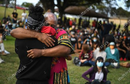 Pastor James Thomas, right, is hugged after a speach at a Black Lives Matter Los Angeles rally to call for justice in the fatal shooting of KennethRoss Jr., who was shot by a Gardena police officer in2018.
