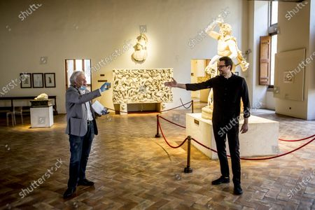 Director and actor Abel Ferrara, left, acknowledges Italian poet Gabriele Tinti after performing a reading of his poems inspired by 'Suicide Gaul' at Palazzo Altemps' National Roman Museum in Rome