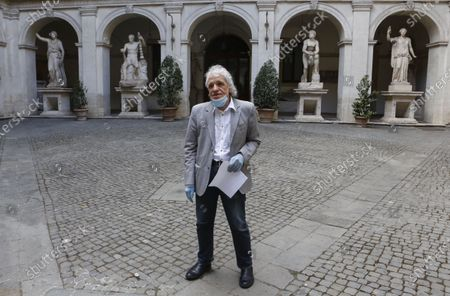 Stock Picture of Director and actor Abel Ferrara poses for photographers prior to reading poems inspired by the 'Suicide Gaul', composed by the Italian poet Gabriele Tinti, at Palazzo Altemps' National Roman Museum in Rome
