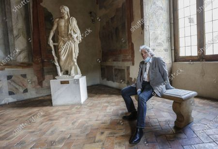 Stock Photo of Director and actor Abel Ferrara poses prior to reading poems inspired by the 'Suicide Gaul', composed by the Italian poet Gabriele Tinti at Palazzo Altemps' National Roman Museum in Rome