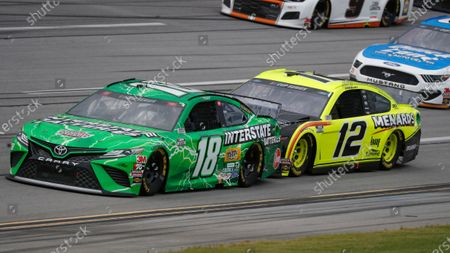Kyle Busch (18) leads Ryan Blaney (12) during a NASCAR Cup Series auto race at Talladega Superspeedway in Talladega Ala