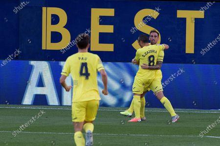 Villarreal's striker Paco Alcacer (R) celebrates with his teammate Santi Cazorla (C) after scoring the 1-0 during the Spanish LaLiga match between Villarreal CF and Sevilla FC at Estadio de La Ceramica stadium in Vila-real, eastern Spain, 22 June 2020.
