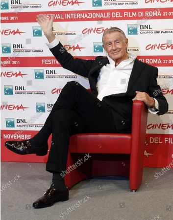 Director Joel Schumacher waves during a photo call for Cinema and Advertising: Joel Schumacher directs Campari, at the Rome International Film Festival. A representative for Schumacher said the filmmaker died, in New York after a year-long battle with cancer. He was 80