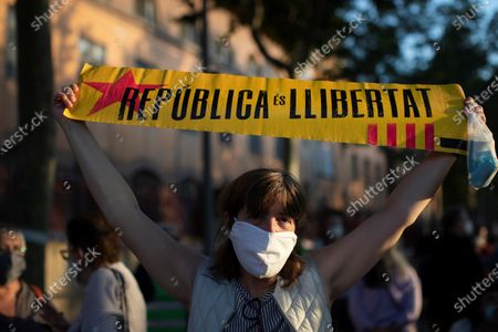 People wearing face masks attend a demonstration against the imprisonment of the Catalonia's parliament former president Carme Forcadell next to Wad-Ras prison in Barcelona, Catalonia, Spain, 22 June 2020. Forcadell enters prison today after Spanish Supreme Court condemned her to 11 years and half for sedition during the 'proces' trial'.