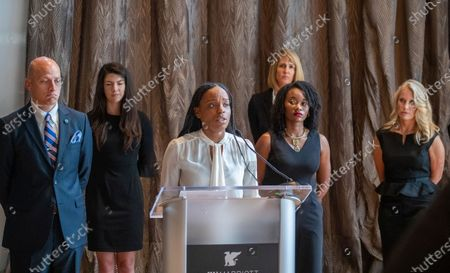 "Shernae Hughes, second from right, listens as Janesha Morgan, center, both Black survivor of alleged sexual assault by former USC gynecologist George Tyndall, speaks while they and attorneys hold a news conference to call on USC Board of Trustees Chairman Rick Caruso to ""keep his promise to release an internal investigation of the Tyndall scandal,"" which they allege also included decades of racism. Attorney Vince Finaldi, left, of Manly, Stewart & Finaldi Lawyers, says Caruso has backtracked on his promise to release the Tyndall investigation report, stating the need to ""balance"" transparency against privacy and `the concerns of outside investigations and litigation."" Photos taken at The Mixing Room at JW Marriott, L.A. LIVE"