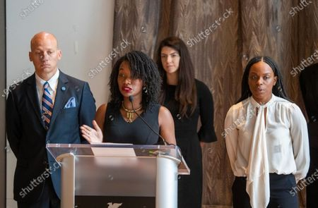"Stock Image of Janesha Morgan, fourth from left, listens as Shernae Hughes, second from left, both Black survivors of alleged sexual assault by former USC gynecologist George Tyndall, speaks while they and their attorneys hold a news conference to call on USC Board of Trustees Chairman Rick Caruso to ""keep his promise to release an internal investigation of the Tyndall scandal,"" which they allege also included decades of racism. Attorney Vince Finaldi, left, of Manly, Stewart & Finaldi Lawyers, says Caruso has backtracked on his promise to release the Tyndall investigation report, stating the need to ""balance"" transparency against privacy and `the concerns of outside investigations and litigation."" Photos taken at The Mixing Room at JW Marriott, L.A. LIVE"