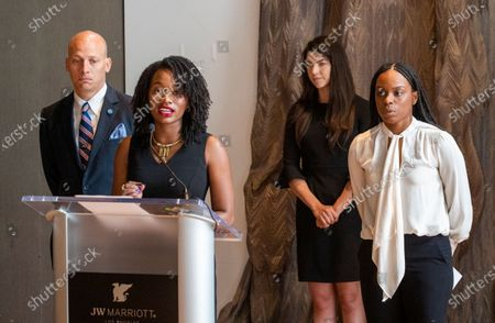 "Janesha Morgan, right, listens as Shernae Hughes, center, both Black survivors of alleged sexual assault by former USC gynecologist George Tyndall, speaks while they and their attorneys hold a news conference to call on USC Board of Trustees Chairman Rick Caruso to ""keep his promise to release an internal investigation of the Tyndall scandal,"" which they allege also included decades of racism. Attorney Vince Finaldi, left, of Manly, Stewart & Finaldi Lawyers, says Caruso has backtracked on his promise to release the Tyndall investigation report, stating the need to ""balance"" transparency against privacy and `the concerns of outside investigations and litigation."" Photos taken at The Mixing Room at JW Marriott, L.A. LIVE"
