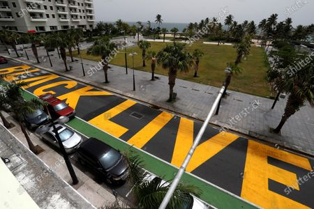 'Black Lives Matter' is painted next to La Ventana al Mar Park on the popular Ashford Avenue in Condado, in San Juan, Puerto Rico, 22 June 2020. A group of young Puerto Ricans painted last Saturday the slogan symbol of the recent anti-racist protests worldwide, suggested and paid for by the Puerto Rican trap and reggaeton singer Bad Bunny through his foundation 'Good Bunny'.