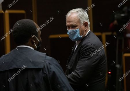 Advocate Muzi Sikhakhane (L), senior council to South Africa's former President Jacob Zuma, and Advocate Barry Roux (R) representing Thales during pre-court  at the Pietermaritzburg High Court in Pietermaritzburg, South Africa, 23 June 2020. Former President Zuma stands accused of taking kickbacks before he became president from a 51 billion rand (3.4 billion US dollar) purchase of fighter jets, patrol boats and military equipment manufactured by five European firms, including French defence company Thales.