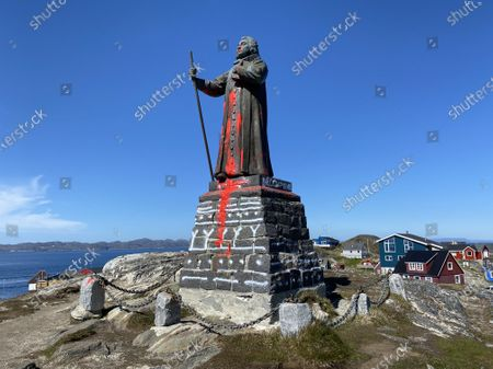 The vandalized statue of Danish-Norwegian colonizer Hans Egede stands in Nuuk, Greenland, 21 June 2020 (issued 23 June 2020). It is believed the vandalization of the statue is related to the Black Lives Matter moment.