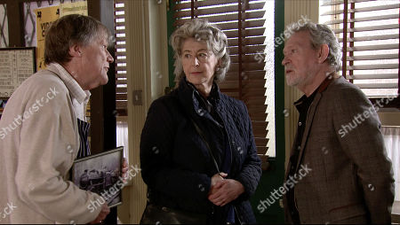 Stock Photo of Coronation Street - Ep 10082 Wednesday 1st June 2020 Evelyn Plummer, as played by Maureen Lipman and Arthur Medwin, as played by Paul Copley meet up for a coffee and a cake in the cafe. To Evelyn's irritation, Roy Cropper as played by David Neilson and Arthur discover they have a shared love of steam trains. When Roy suggests they meet in the Rovers later to discuss the Carlisle to Settle line in more detail, Arthur's delighted whilst Evelyn forces a smile.