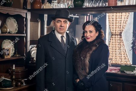 Stock Image of Rowan Atkinson as Maigret and Lucy Cohu as Madame Maigret.