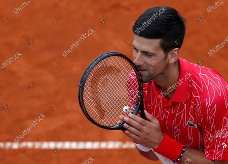 Serbia's Novak Djokovic reacts during a tennis doubles match with Jelena Jankovic against Serbia's Nenad Zimonjic and Olga Danilovic at charity tournament Adria Tour, in Belgrade, Serbia. Novak Djokovic has tested positive for the coronavirus after taking part in a tennis exhibition series he organized in Serbia and Croatia. The top-ranked Serb is the fourth player to test positive for the virus after first playing in Belgrade and then again last weekend in Zadar, Croatia. His wife also tested positive
