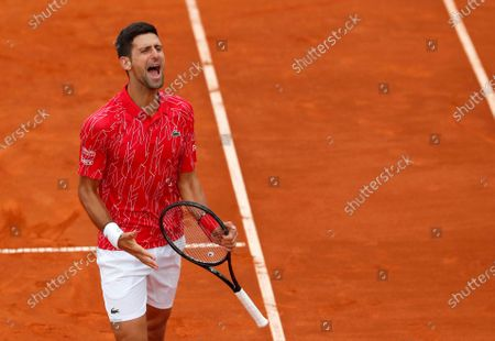In this . photo, Serbia's Novak Djokovic reacts during a tennis doubles match with Jelena Jankovic against Serbia's Nenad Zimonjic and Olga Danilovic at charity tournament Adria Tour, in Belgrade, Serbia. Novak Djokovic has tested positive for the coronavirus after taking part in a tennis exhibition series he organized in Serbia and Croatia. The top-ranked Serb is the fourth player to test positive for the virus after first playing in Belgrade and then again last weekend in Zadar, Croatia. His wife also tested positive