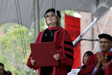 Mathematician Ingrid Daubechies is presented with an honorary Doctor of Science degree during Harvard University commencement exercises. An international team of mathematicians whose theories have improved the compression of large digital files of data, including images and sound, will be recognized by one of this year's Princess of Asturias awards, one of the most prestigous in the Spanish-speaking world. The Spanish foundation that organizes the annual awards announced Tuesday that the 2020 prize for Scientific and Technical Investigation will go to Yves Meyer, Ingrid Daubechies, Terence Tao and Emmanuel Candes
