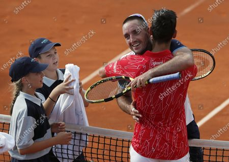 Serbia's Novak Djokovic, front right, hugs with Serbia's Viktor Troicki after their match of the Adria Tour charity tournament in Belgrade, Serbia. Novak Djokovic has tested positive for the coronavirus after taking part in a tennis exhibition series he organized in Serbia and Croatia. The top-ranked Serb is the fourth player to test positive for the virus after first playing in Belgrade and then again last weekend in Zadar, Croatia. Viktor Troicki said Tuesday that he and his pregnant wife have both been diagnosed with the virus