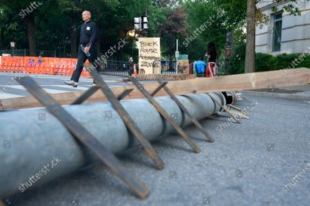 Stock Picture of A homemade barricade lines the street near Lafayette Square across from the White House in Washington D.C., U.S.,, after police tried to open the street to traffic Monday night.