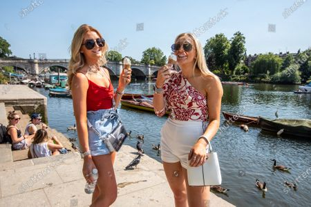Editorial picture of Warm weather sees members of the public go out to enjoy the sunshine and warm weather as the 2 metre rules is reduced to 1, London, UK - 23 Jun 2020