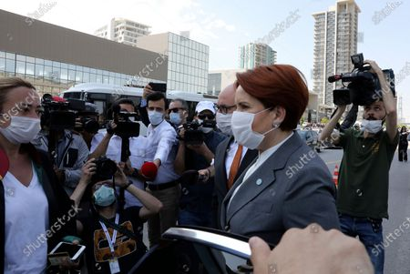 Meral Aksener, the leader of opposition IYI (Good) Party, arrives to support the heads of Turkish lawyers' associations surrounded by riot police, in Ankara, Turkey, . Turkish authorities on Tuesday allowed a group of top lawyers to continue with their symbolic march into the capital Ankara, ending a more than 24-hour standoff between the lawyers and police