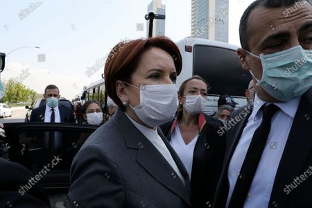 Meral Aksener, the leader of opposition IYI (Good) Party, arrives in support the heads of Turkish lawyers' associations surrounded by riot police, in Ankara, Turkey, . Turkish authorities on Tuesday allowed a group of top lawyers to continue with their symbolic march into the capital Ankara, ending a more than 24-hour standoff between the lawyers and police