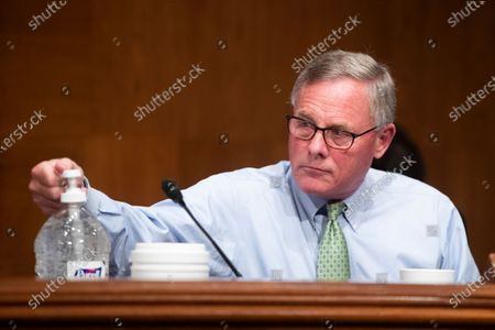 Republican Senator from North Carolina Richard Burr uses hand sanitizer during the US Senate Health, Education, Labor, and Pensions Committee hearing to examine COVID-19, 'focusing on lessons learned to prepare for the next pandemic', on Capitol Hill in Washington DC, USA, 23 June 2020.