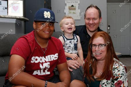 The Dunn family is pictured in their home, in Oklahoma City. From left are Izzy Simons, Cooper Dunn, Josh Dunn and Sarah Dunn. Sarah Dunn, who grew up in rural Kansas, has learned much about race since she and her husband, Josh, took custody of Izzy six years ago