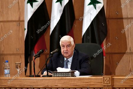 """In this photo released by the Syrian official news agency SANA, Syrian Foreign Minister Walid al-Moallem speaks during a news conference, in Damascus, Syria, . Walid al-Moallem accused the United States on Tuesday of allegedly """"seeking to starve the people"""" of Syria by imposing new sanctions and opening the door for """"terrorism"""" to return to the war-torn country"""